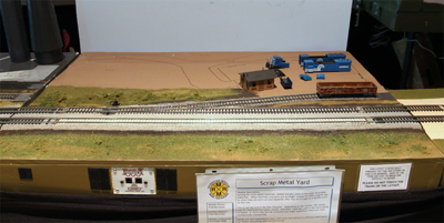 The scrap yard module.  The siding is in  place, but additional scenery is needed.